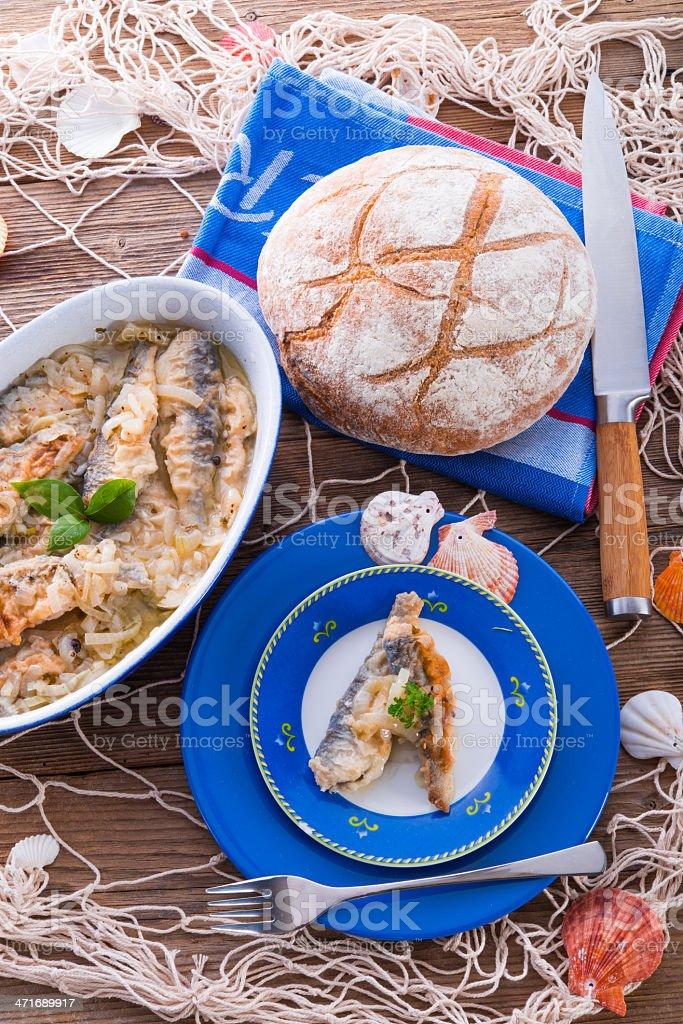 Crossly inlaid fried herrings stock photo