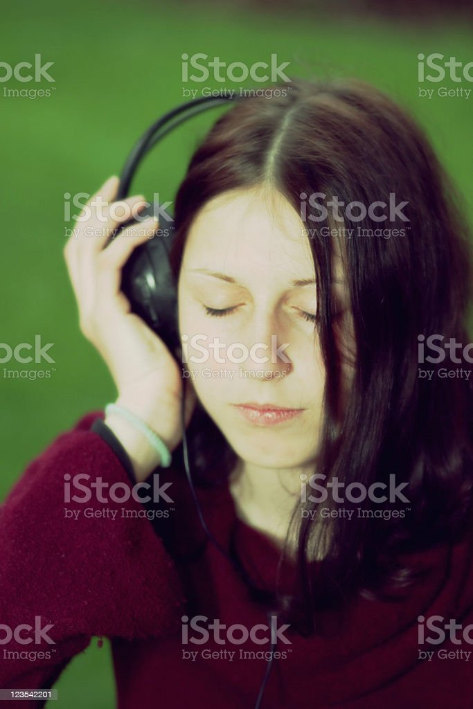 Crossprocessed girl listening to music royalty-free stock photo