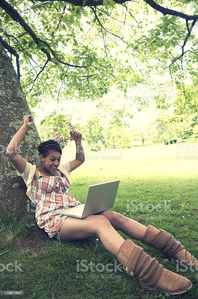 Cross-Processed Girl w Laptop in Park royalty-free stock photo