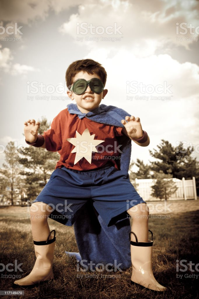 Cross-processed Youth Pretending to be Superhero in Homemade Costume Outdoors royalty-free stock photo