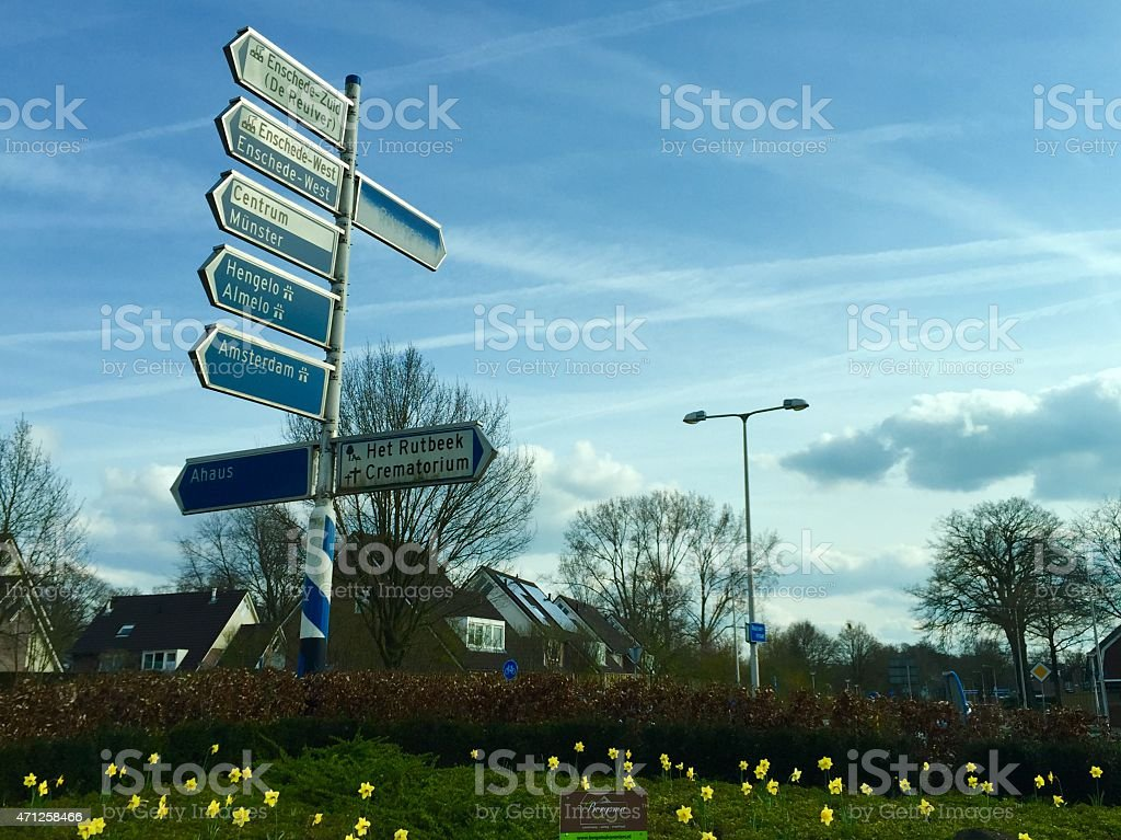 Crossroad and roundabout with signs in Enschede The Netherlands stock photo