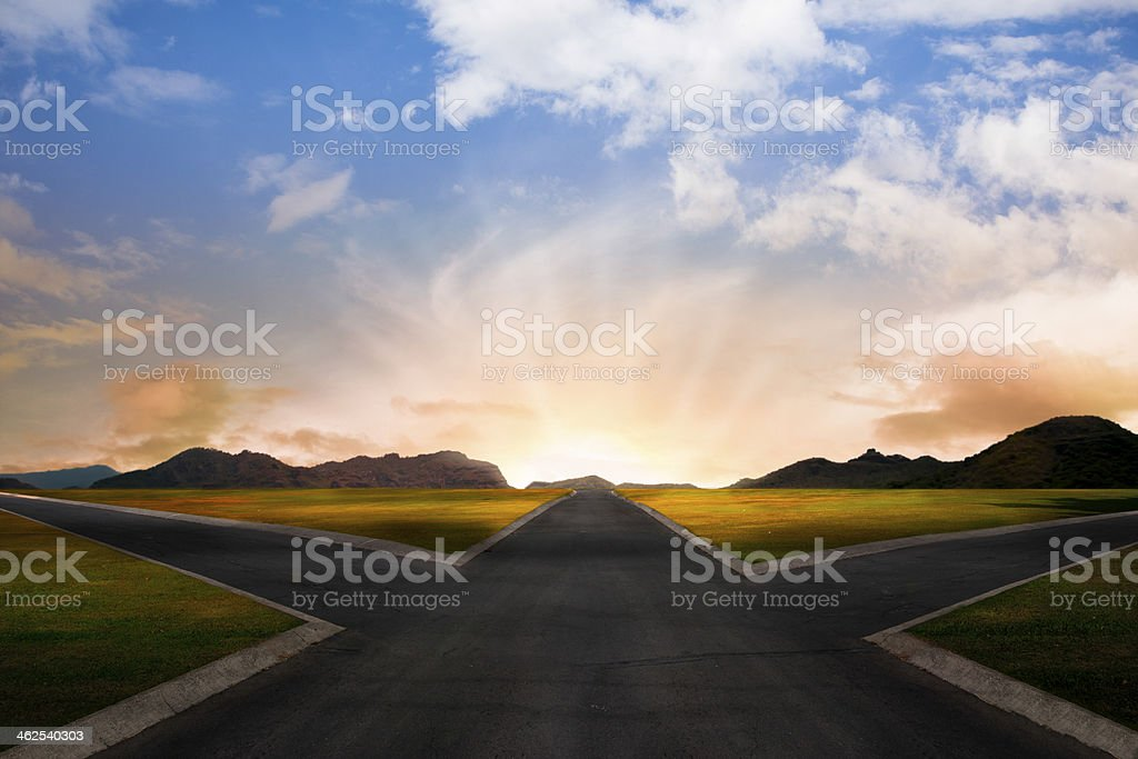 crossroad at dawn in rural landscape stock photo