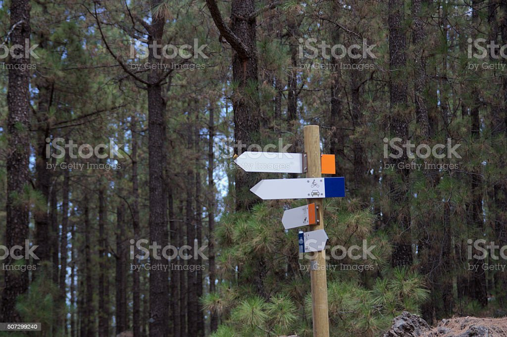 Crossroad wooden directional arrow signs stock photo