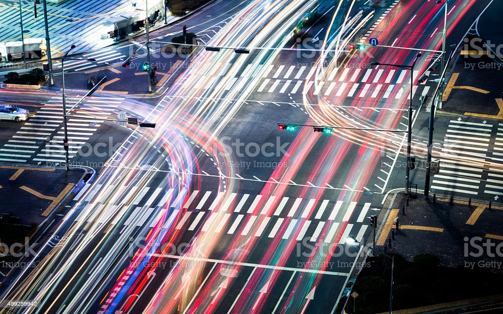 Crossroads Colorful Car Trails stock photo