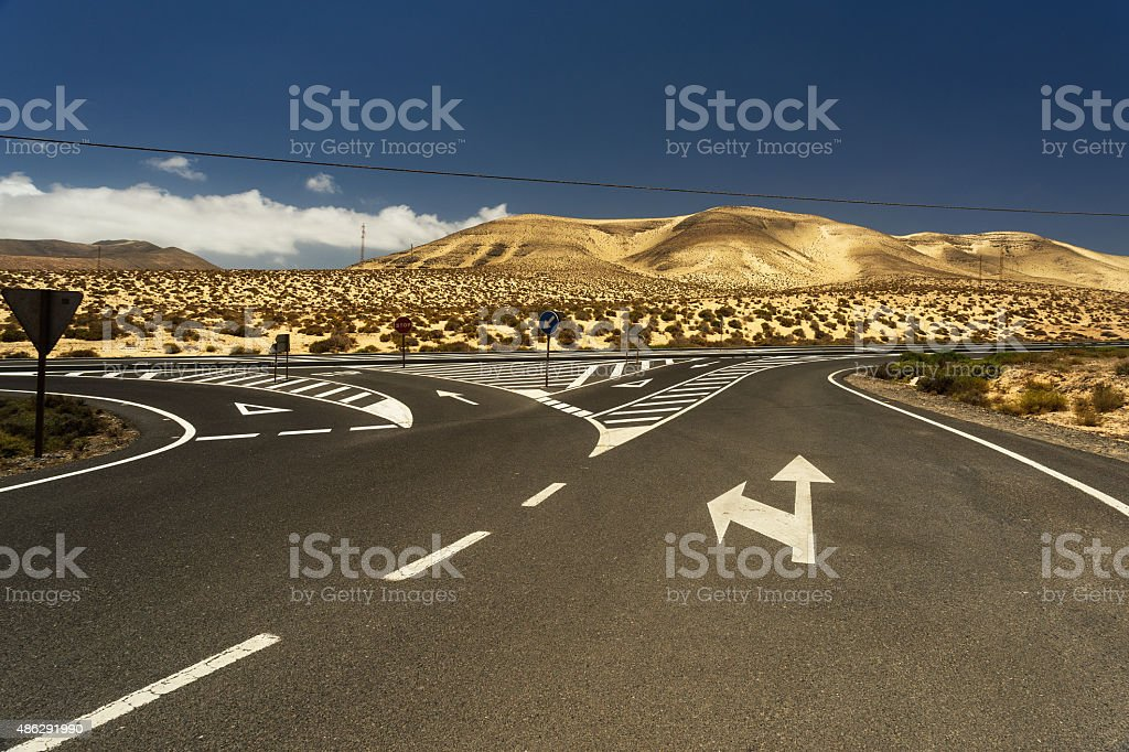 Crossroads of the road in the mountains on Fuerteventura stock photo