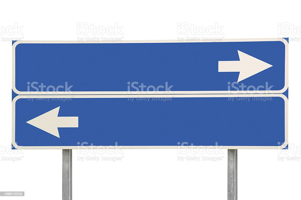 Crossroads Road Sign, White Arrows Blue Background, Isolated Copy Space stock photo