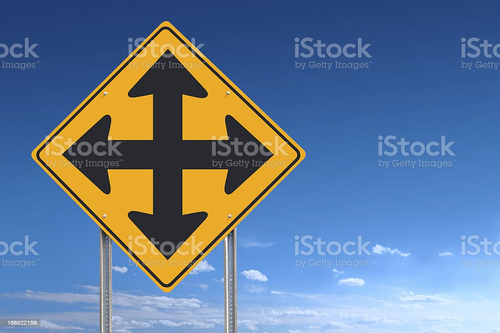 Crossroads Traffic Sign Post Over Blue Sky Background stock photo