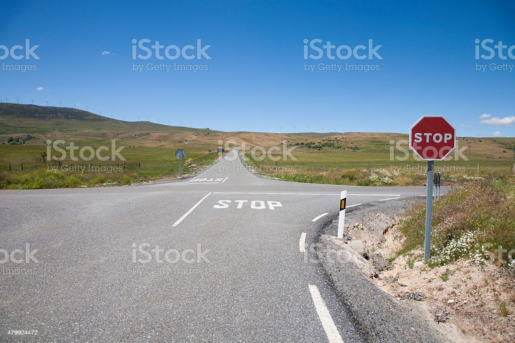 crossroads with stop signal stock photo