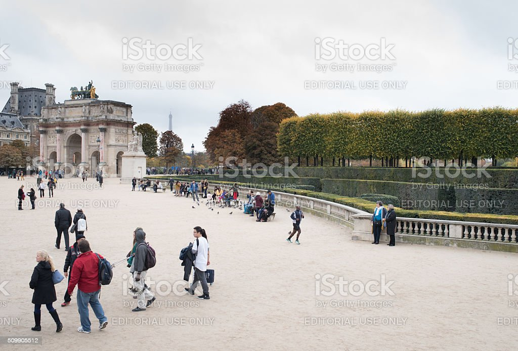 Cross-section of people in Paris Tuileries gardens stock photo