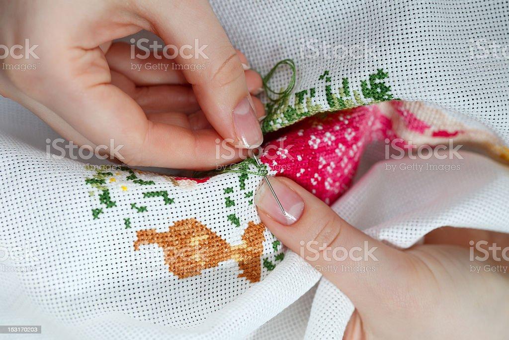 Cross-stitching royalty-free stock photo