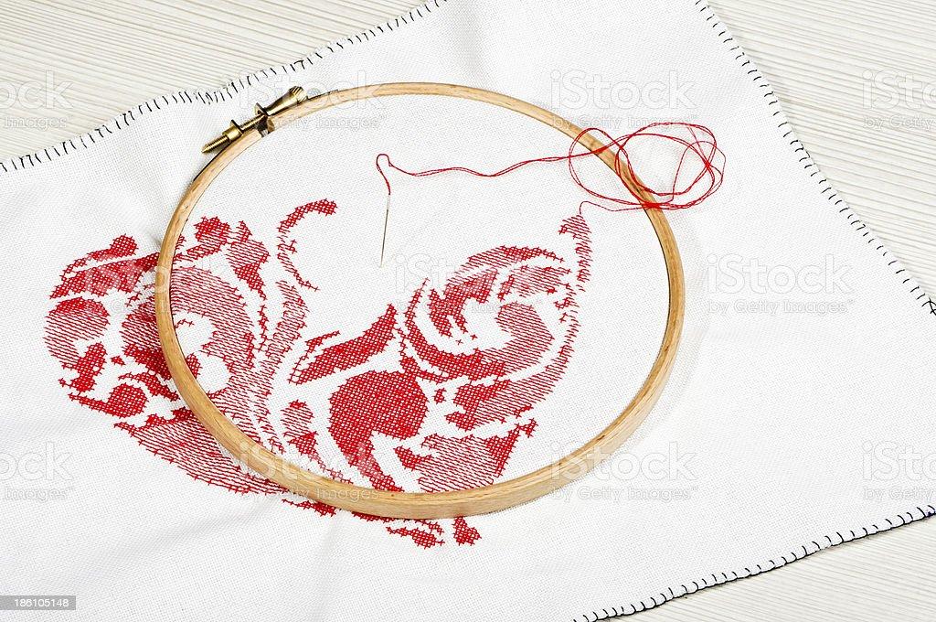 Cross-stitching process royalty-free stock photo