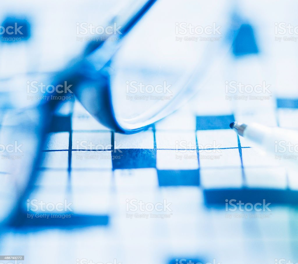 Crossword puzzle with glasses and pen stock photo