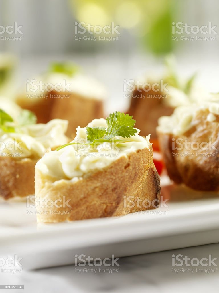 Crostini Topped with Brie Cheese royalty-free stock photo