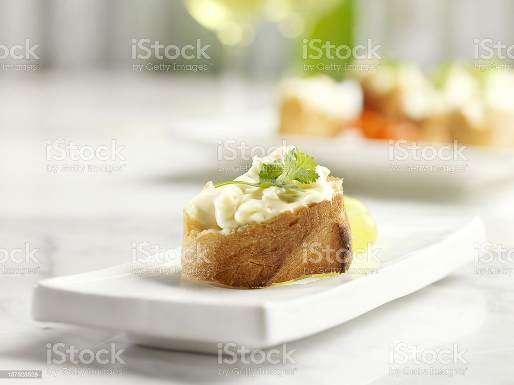 Crostini Topped with Brie Cheese stock photo