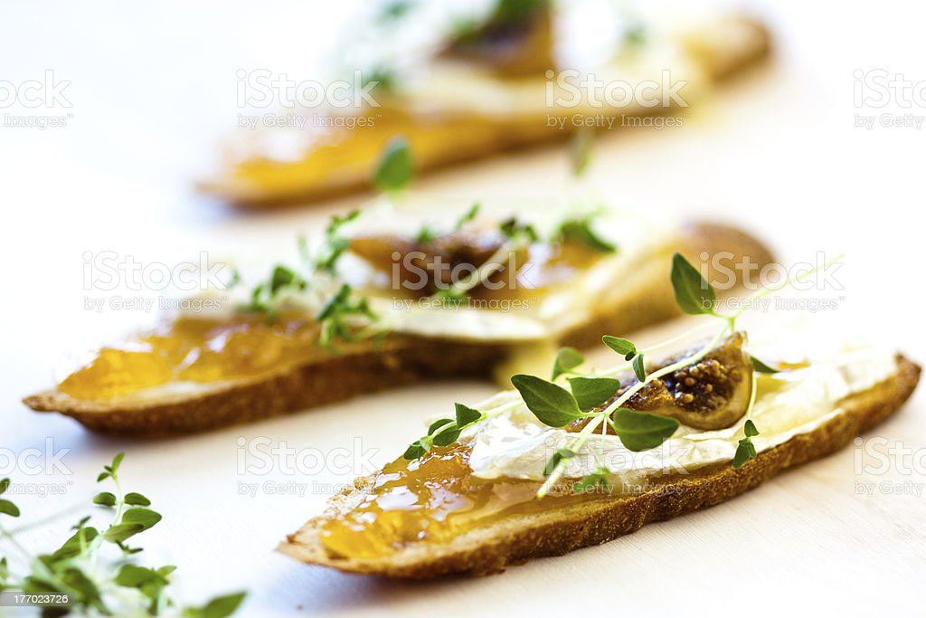 crostini with chutney and brie stock photo