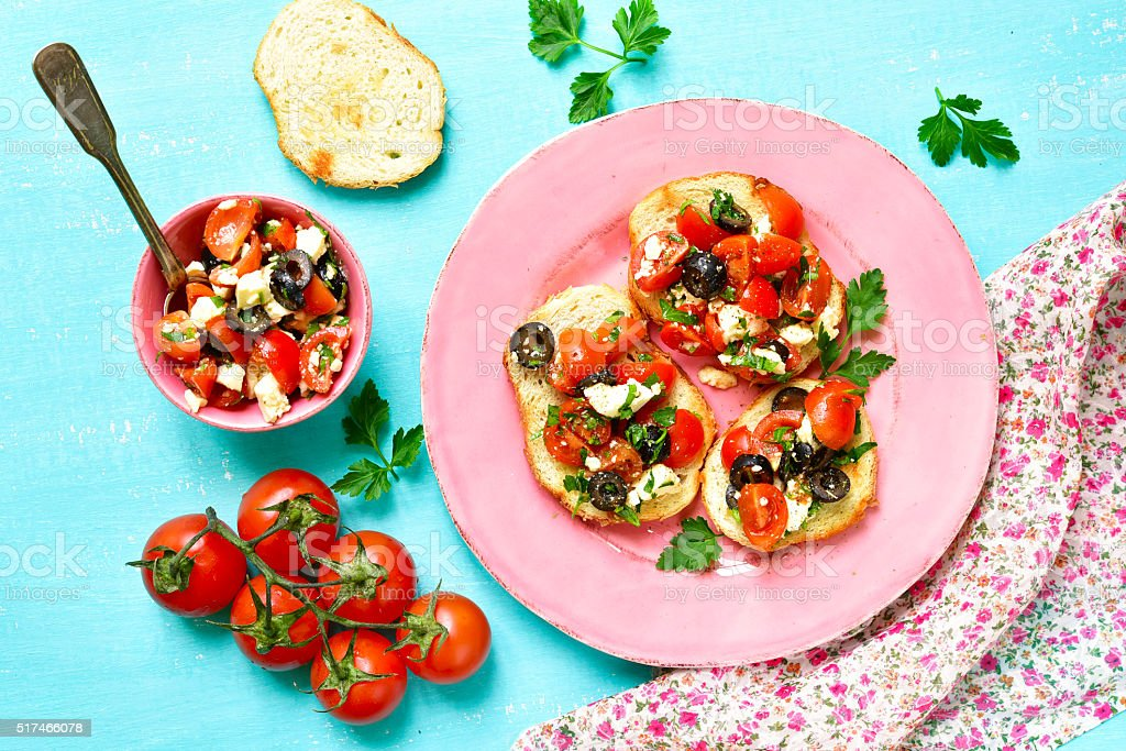 Crostini with tomatoes,feta and olives. stock photo