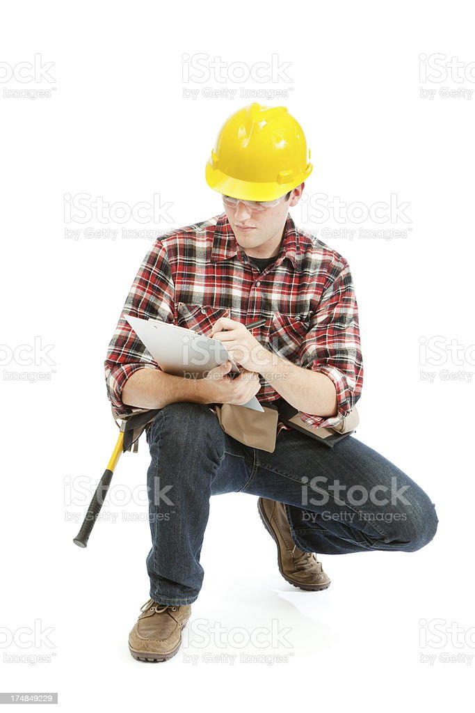 Crouching Construction Contractor Workman with Clipboard on White Background royalty-free stock photo