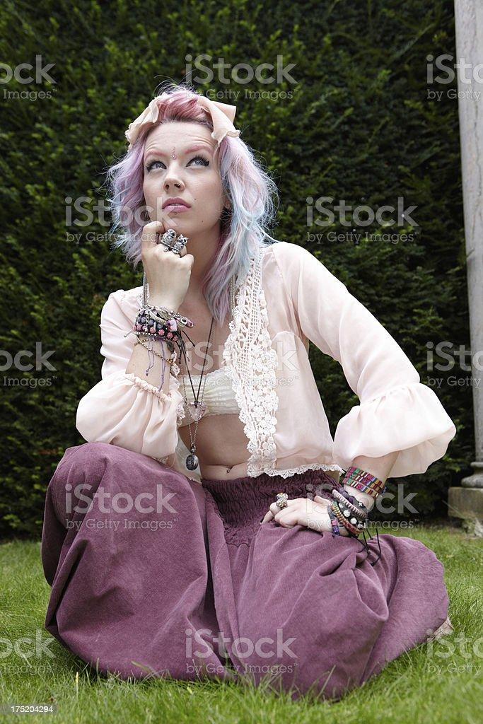 Crouching indie teenager royalty-free stock photo