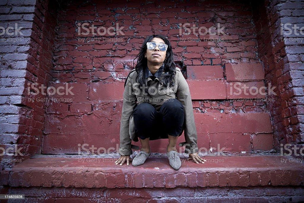 Crouching on Ledge royalty-free stock photo
