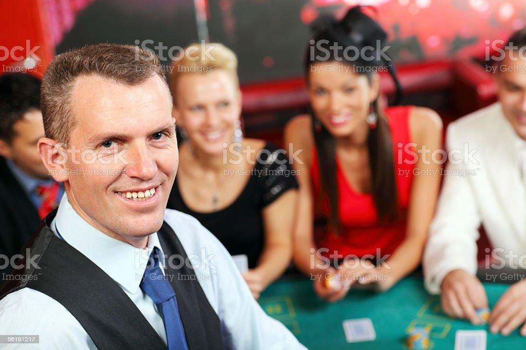 Croupier and players casino. stock photo