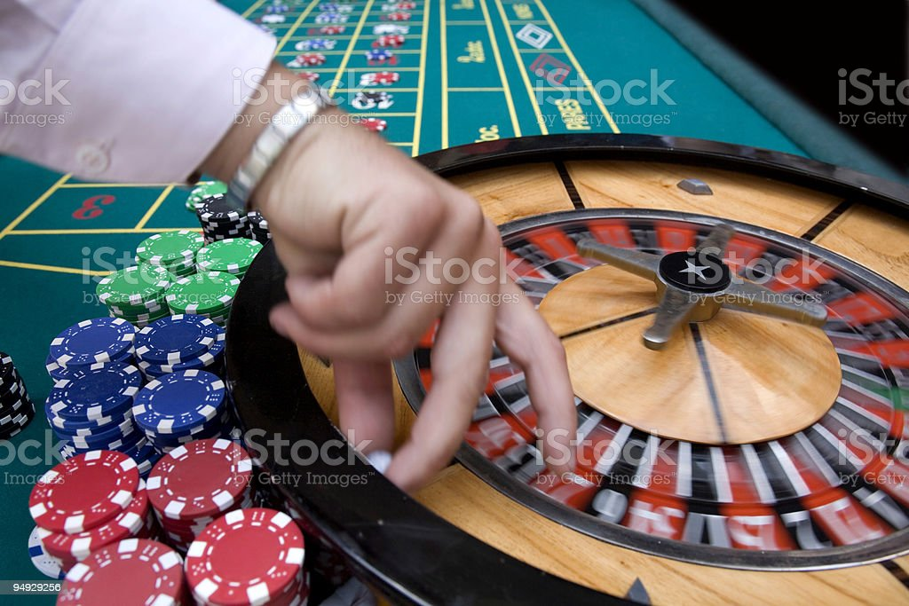 Croupier at roulette table royalty-free stock photo