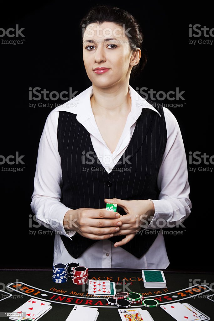 Croupier showing Black Jack cards stock photo