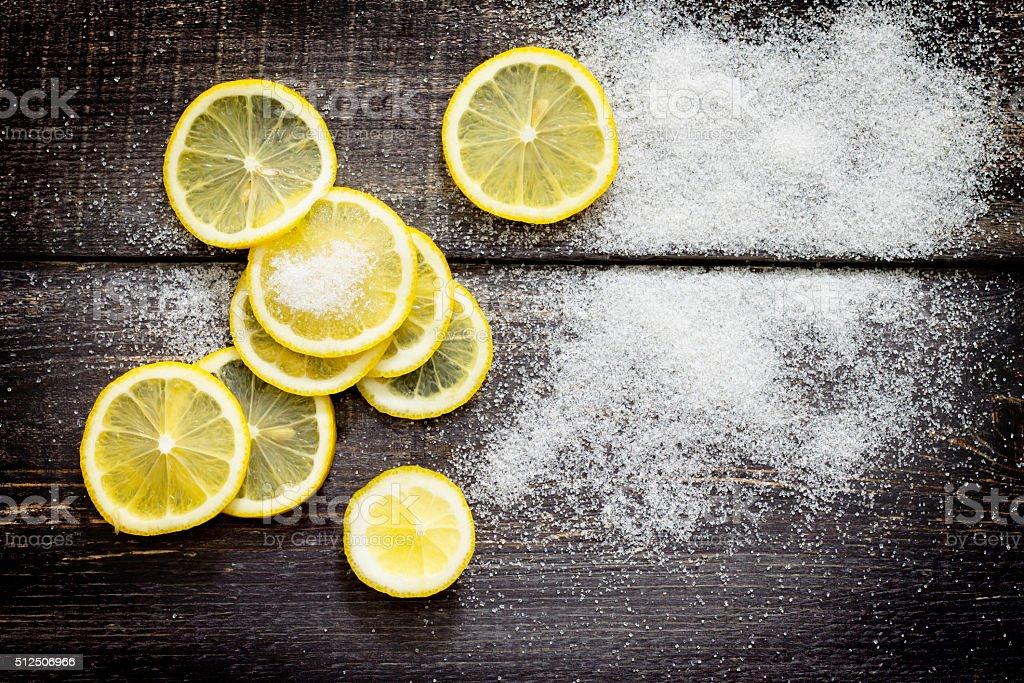 Crowbar fresh lemon and sugar on the table, top view. stock photo