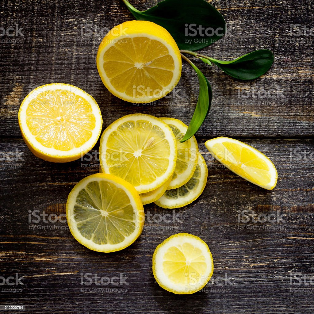 Crowbar fresh lemon on the table, top view. stock photo