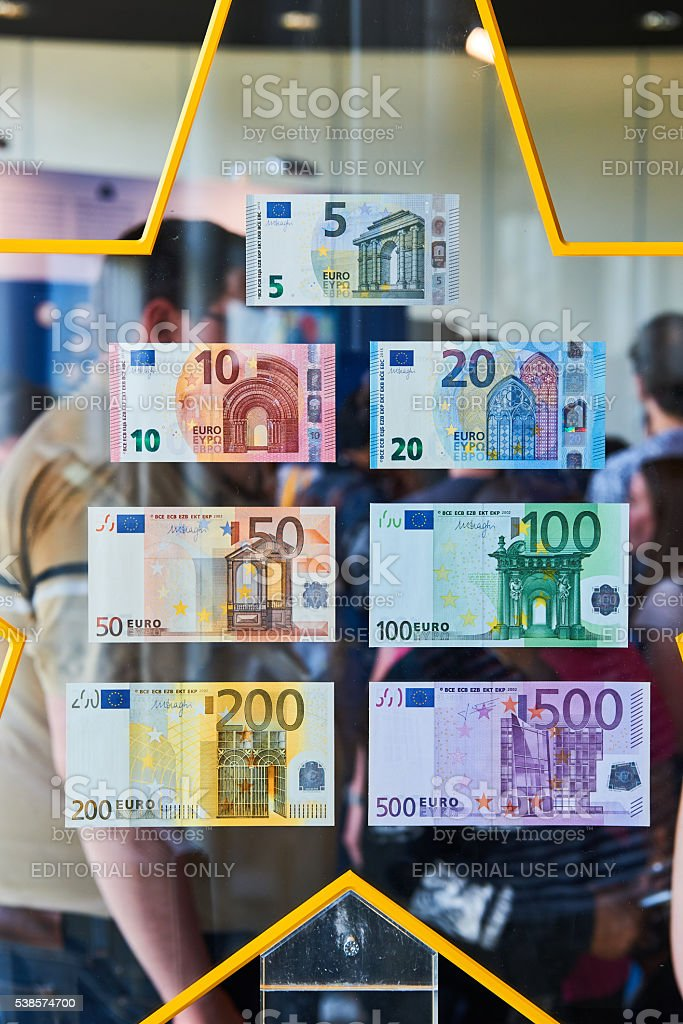 Crowd admiring all European Union Euro notes stock photo