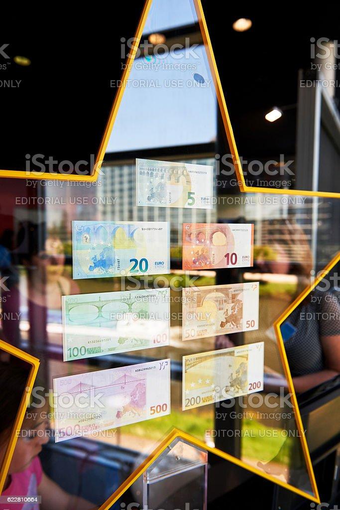 Crowd admiring all European Union Euro notes stock photo