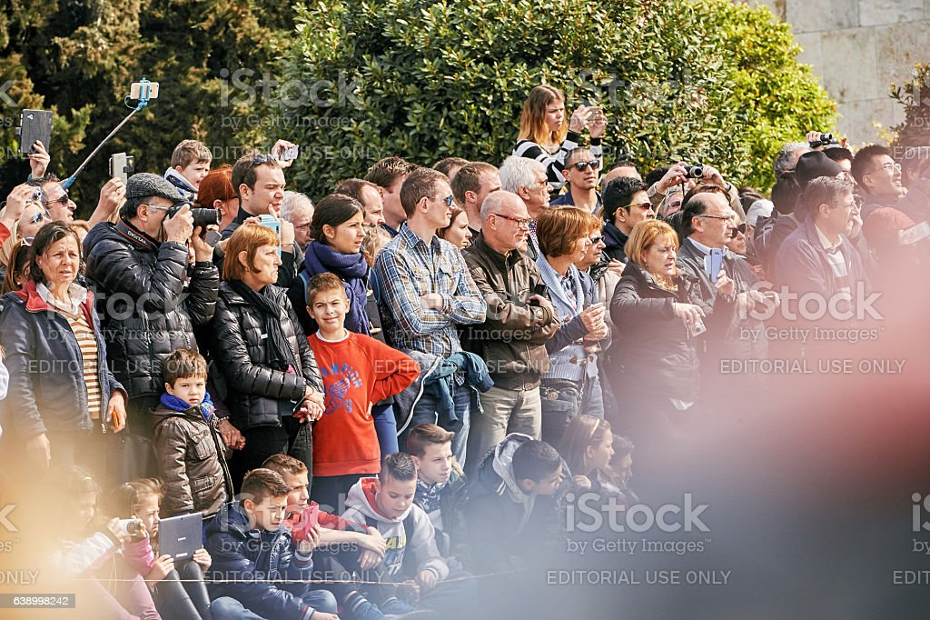 Crowd admiring and photographing event in Athens stock photo