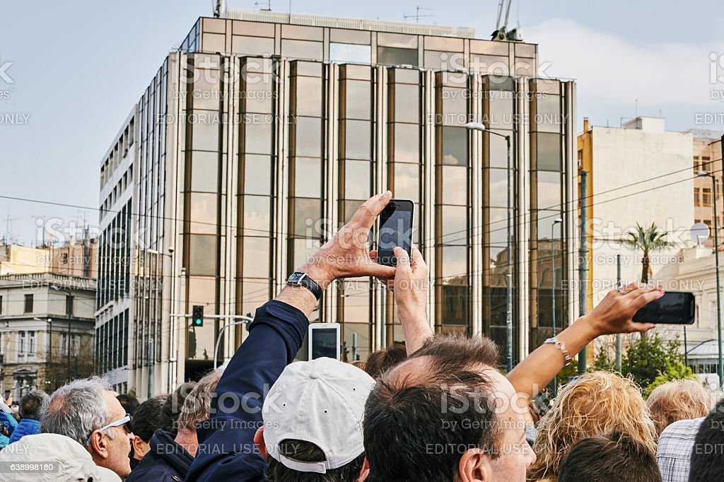 Crowd admiring and photographing the changing of the honor Evzones stock photo