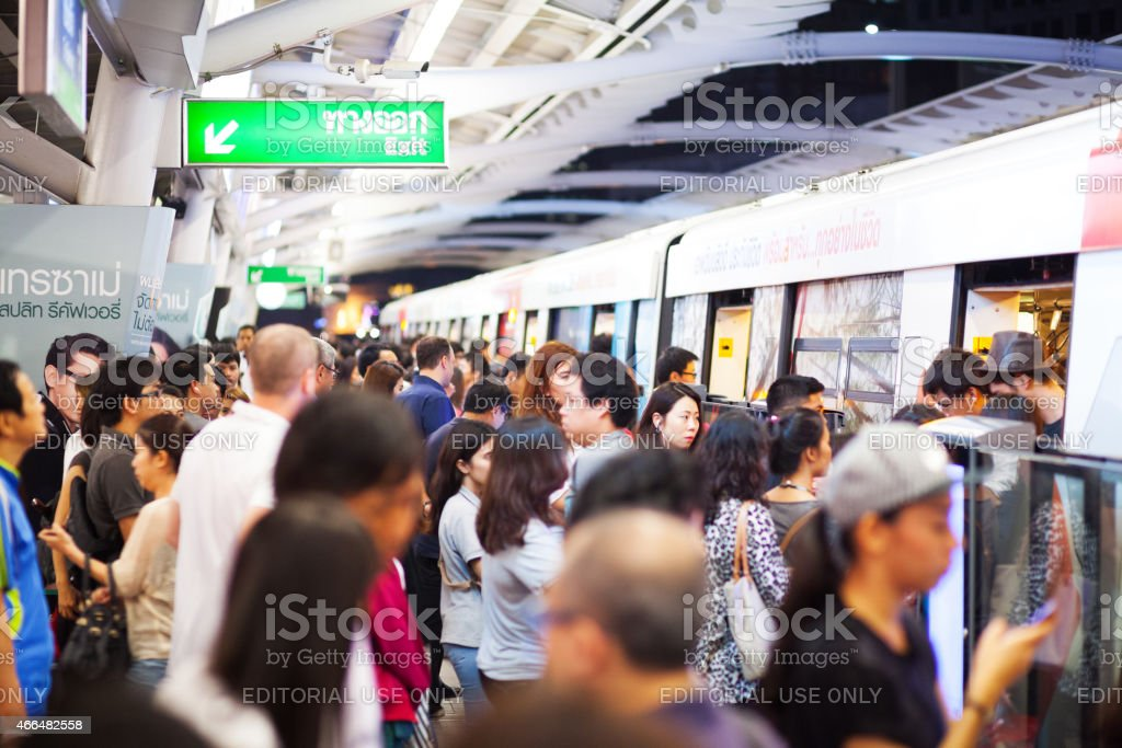 Crowd and night rush hour at bts skytrain stock photo