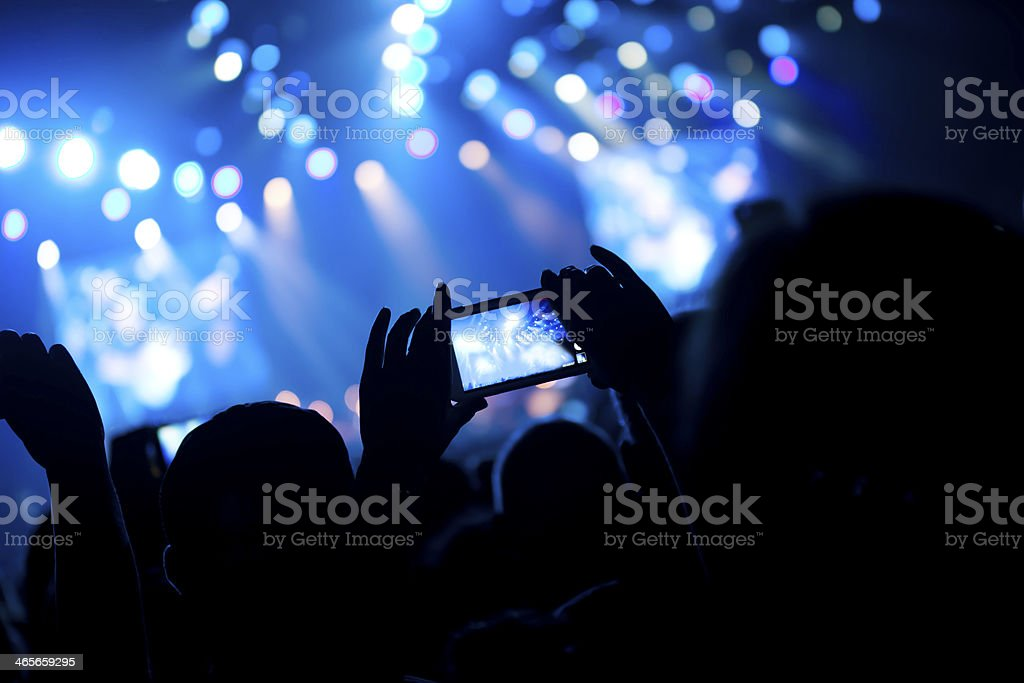 Crowd at concert taking photos on digital devices royalty-free stock photo