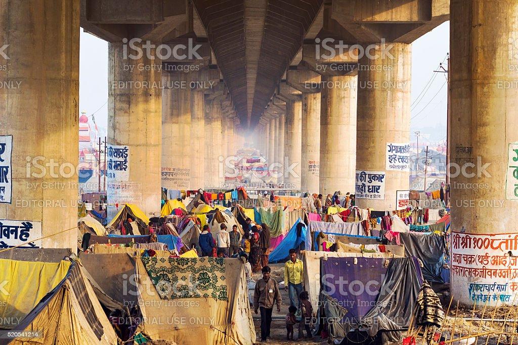 Crowd Camping Under Bridge at Kumbh Mela Festival, Allahabad, India stock photo