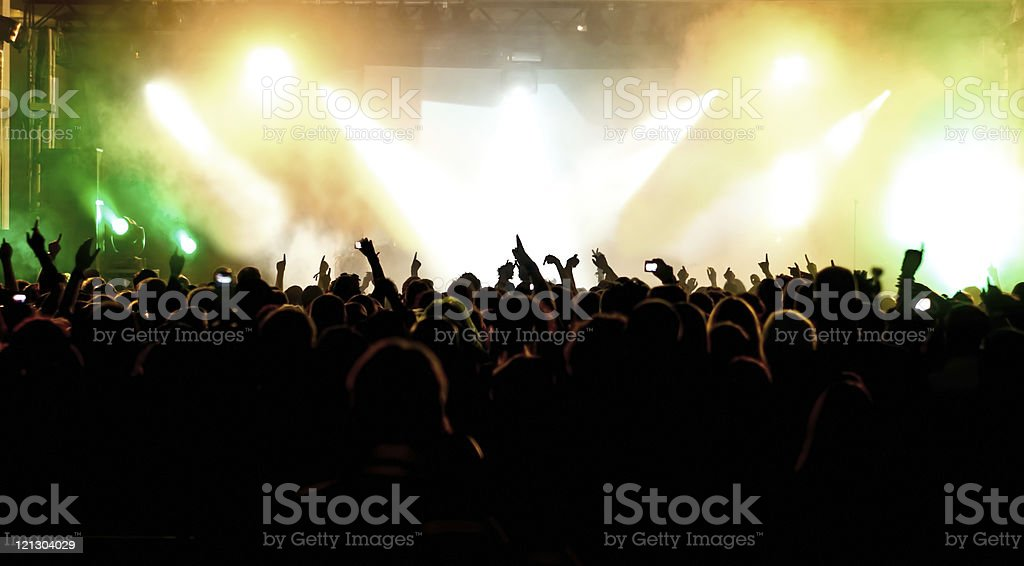 Crowd, colorful lights at concert royalty-free stock photo