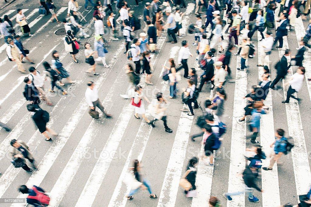 Crowd crossing the street on walkway in Kyoto, Japan stock photo