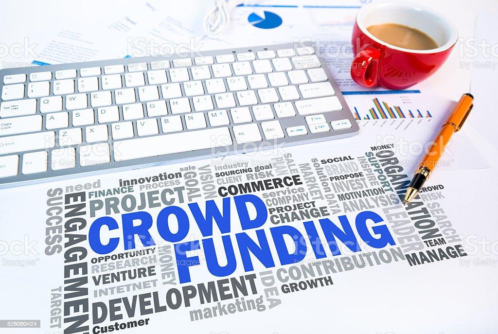 crowd funding word cloud on office scene stock photo