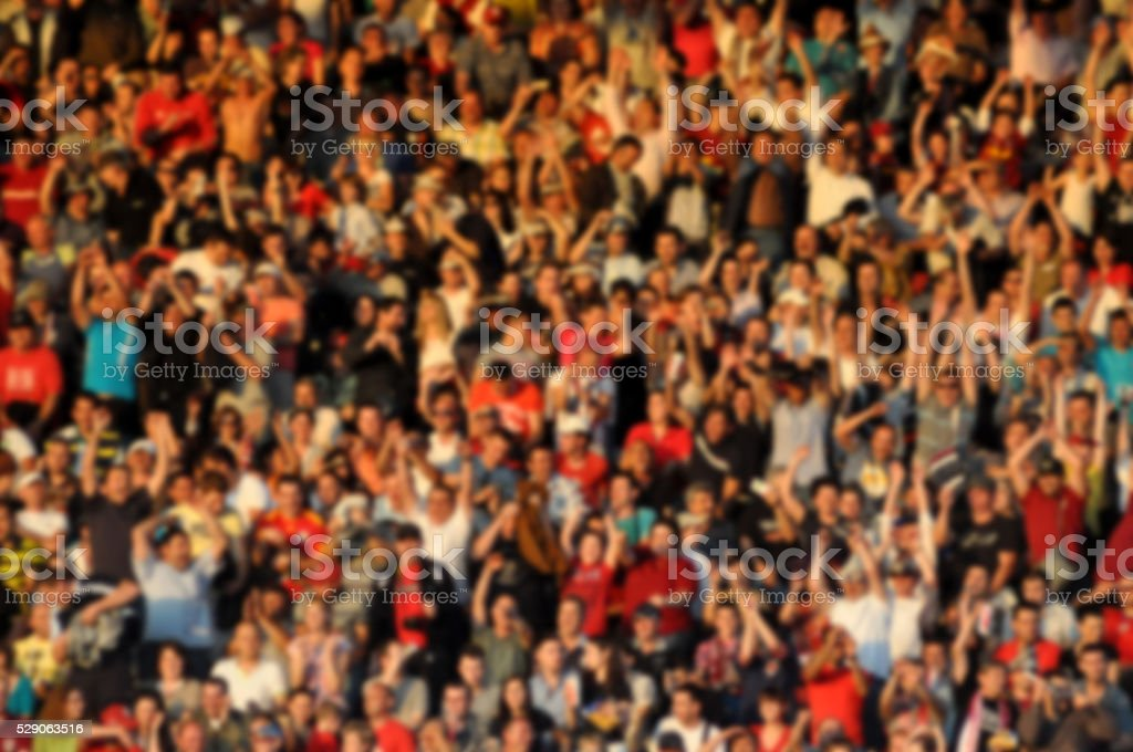 Crowd in a stadium. Blurred heads and faces of spectators stock photo