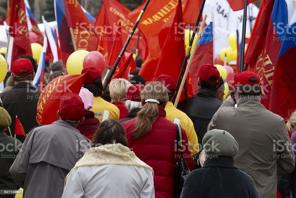 Crowd in protest holding red flags stock photo