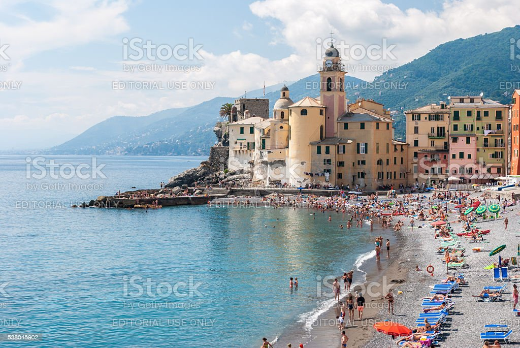 Crowd in the beach of Camogli during a sunny afternoon stock photo
