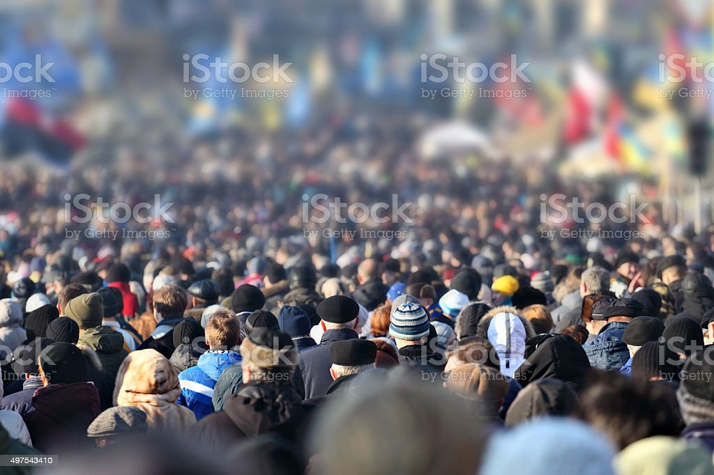 Crowd of anonymous people on street in city center stock photo