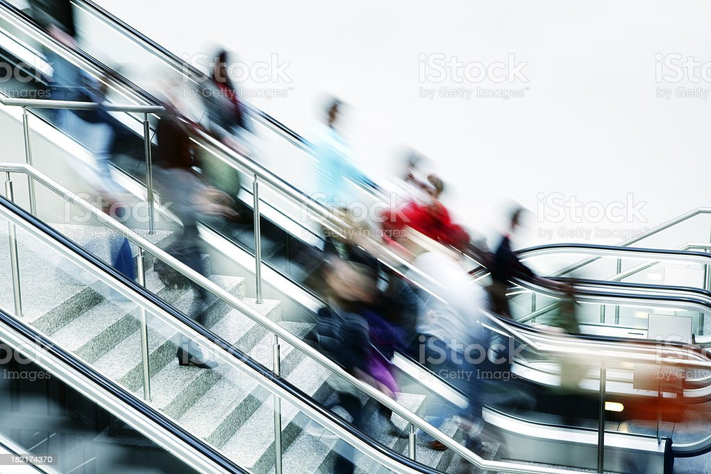 Crowd of Blurred People on Stairs and Escalator royalty-free stock photo