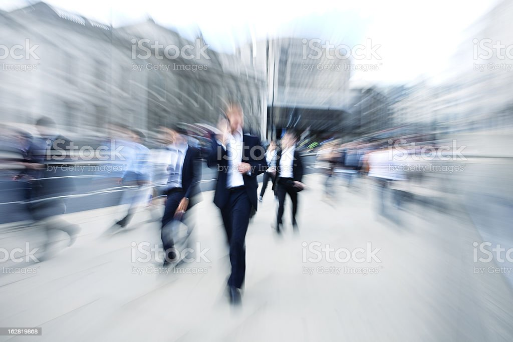 Crowd of Business People, Businessman Using Mobile Phone, Blurred Motion royalty-free stock photo