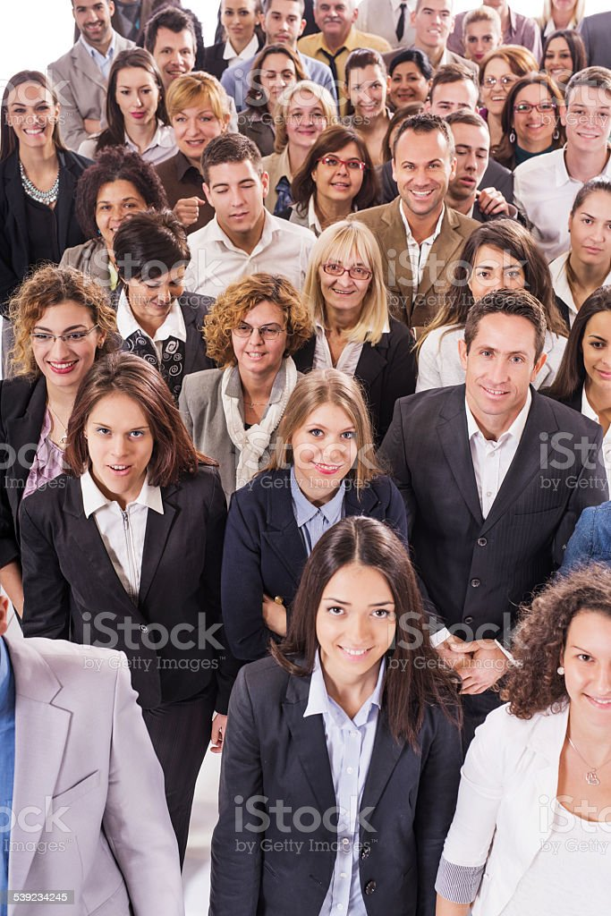Crowd of business people looking at the camera. stock photo