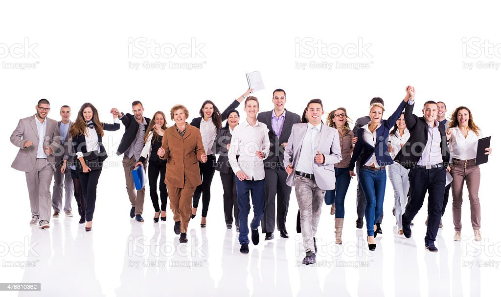 Large group of cheerful business people running and looking at the...