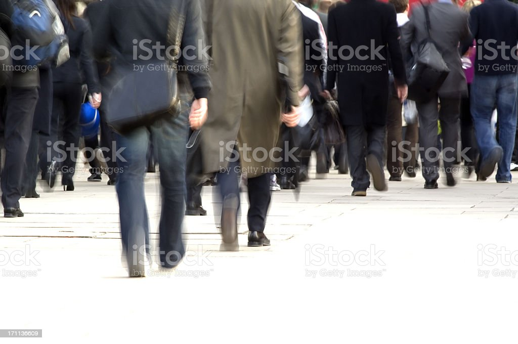 Crowd of commuters feet, movement blur royalty-free stock photo