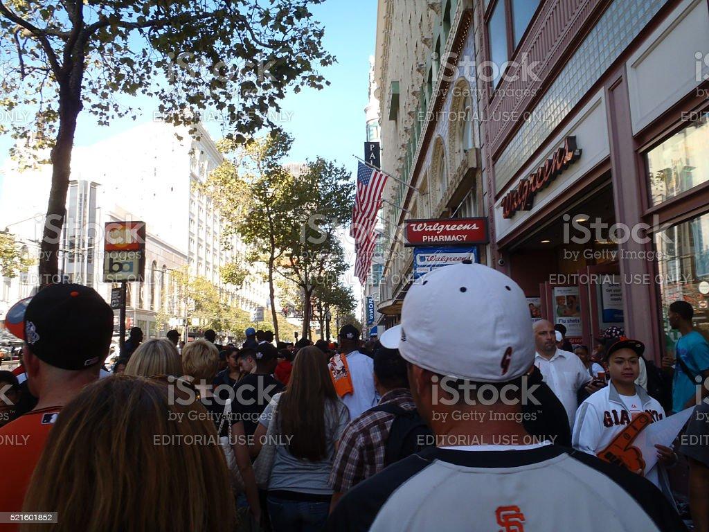Crowd of Giants fans walk down Market Street by Walgreens stock photo