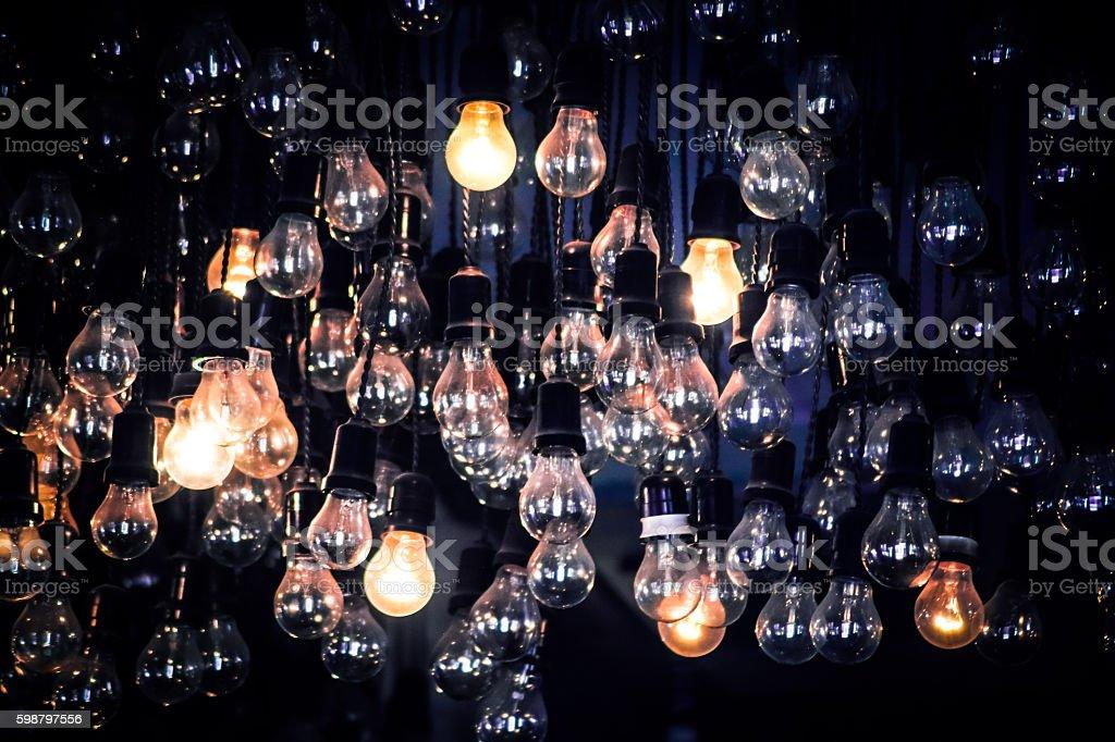 Crowd of Hanging Light Bulbs, Idea concept stock photo