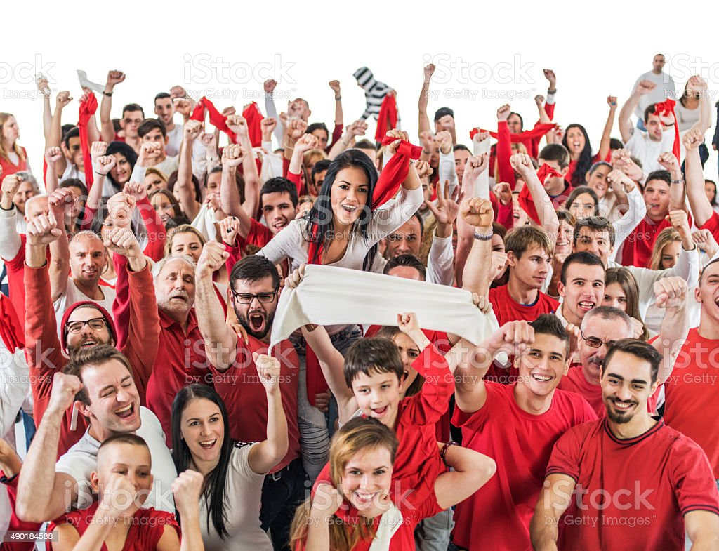 High angle view of large group of ecstatic sport fans cheering with...